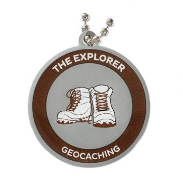 7SofA Travel Tag: The Explorer $5.50 USD  Every day, there's a new adventure out there- and you can't wait to find it. For every geocache you find, you earn two smileys: the one on your profile and the one on your face.  If this sounds like you or someone you know, celebrate with this cool Explorer tag! The tag comes with a chain for hitchhiking!  Find a Traditional geocache to earn the Explorer souvenir.  Size: 1.5 inches (3.8cm) in diameter