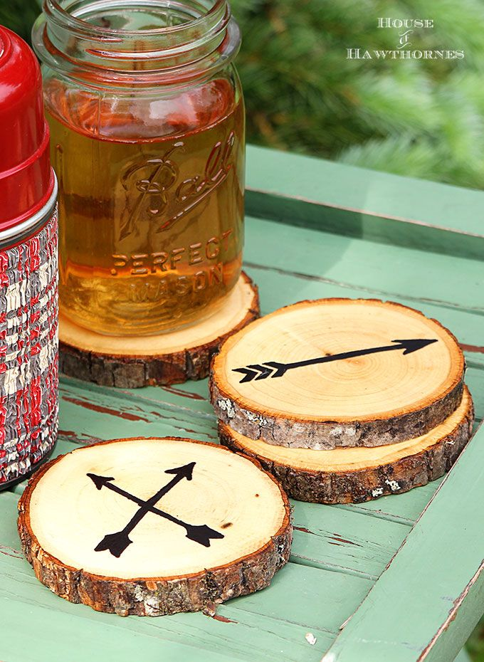 Use a Sharpie to create an arrow motif on craft store wood slices for the perfect coasters.