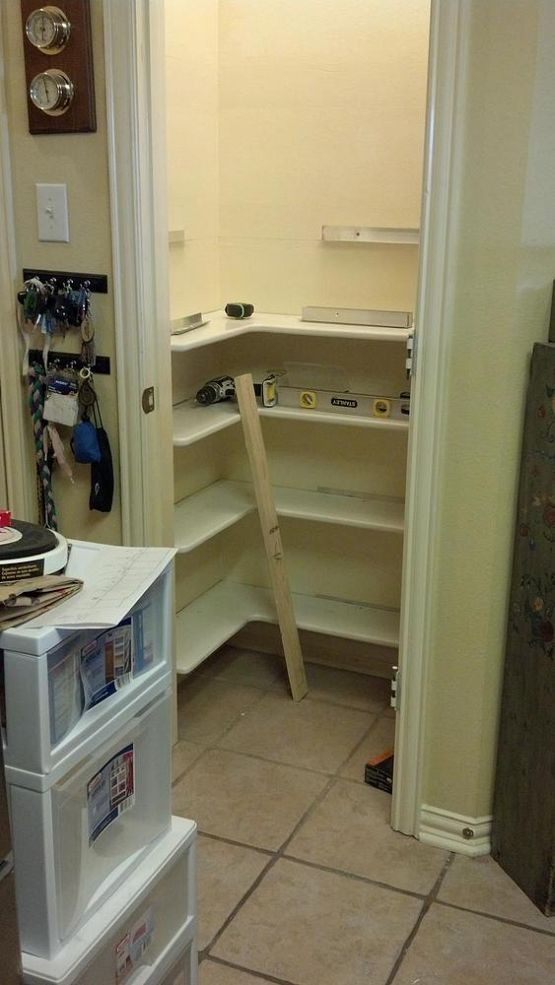 DIY:  Redesigned Pantry - the original shelves were removed, the walls were repaired and repainted, then U-shaped shelves made of MDF were cut to fit the size of the space, painted and installed, utilizing every inch of space.