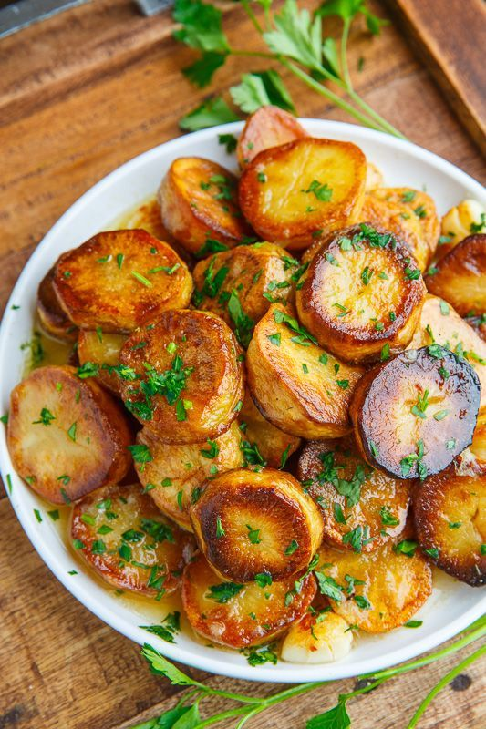 MELTING POTATOES are crispy on the outside and melt I your mouth luxury on the inside with a lemon garlic sauce softening these still crispy potatoes. YUM!