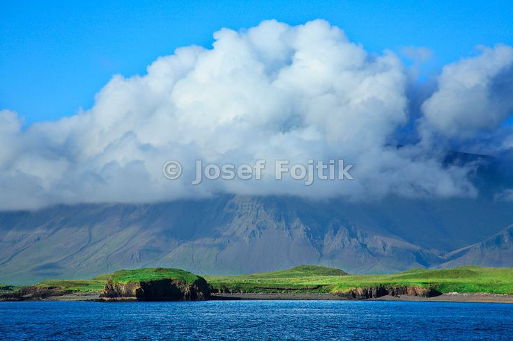A view from the quay of Reykjavik on the Kistufel Mountain in the north-east direction, Iceland....