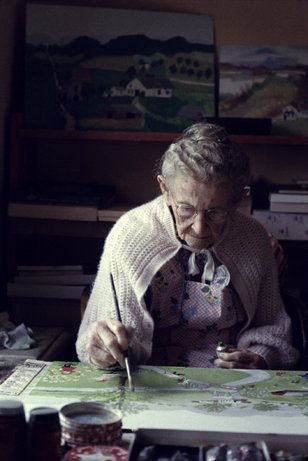 One-hundred-year-old artist Grandma Moses paints at her farm, 1960.