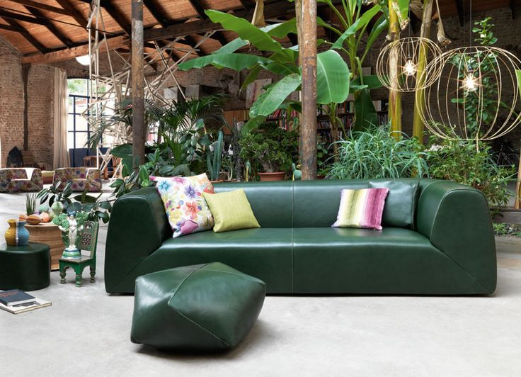 Tropical inspiration for a loft in town. Gravita' sofa and pouf all 100% leather, by MissoniHome. #missonihome