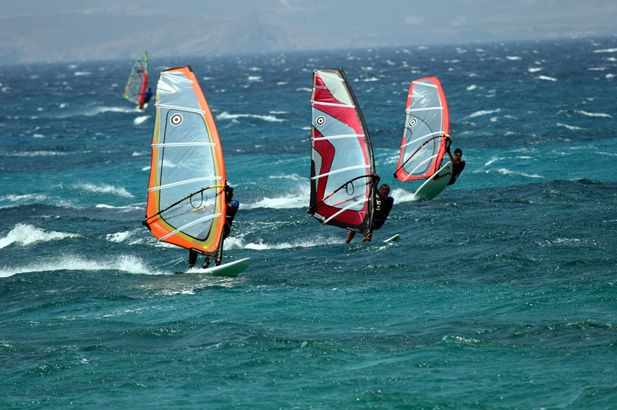 Windsurfing in Paros: Its long, wide sandy beaches are family heaven and there is a huge variety of activities and entertainment. #FiveStarGreece #LuxuryVillas #HolidayMatchmakers