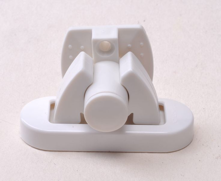 A plastic door stopper-  A spring plastic stopper. Locks the door open. Available in black and white.