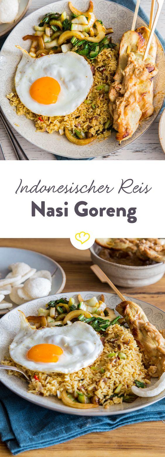 Nasi Goreng wird in Indonesien zusammen mit vielen anderen Köstlichkeiten aufgetischt, schmeckt aber auch im Alleingang einfach lecker.(Fried Rice Recipes)