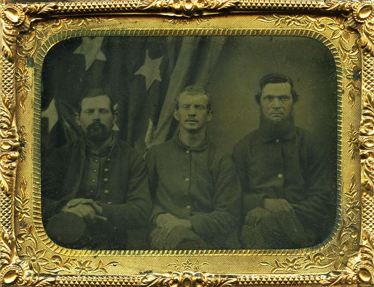 eBay | Wonderful Civil War quarter plate tintype of three patriotic privates posed in front of a large American Flag! A superb horizontal image of three Union soldiers in front of large American Flag, housed in a nice union case.