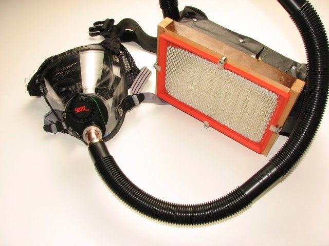 Supplied Air Respirator by Jake von Slatt -- Homemade supplied air respirator constructed from a surplus tear gas mask, sheetmetal enclosure, hard drive cooling fans, automotive AC filter, surplus brass drain pipe, and rechargeable batteries. http://www.homemadetools.net/homemade-supplied-air-respirator-2