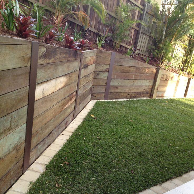 Treated hardwood timber retaining wall
