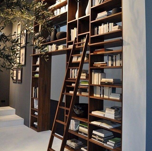 Bookshelf as a space dividor. Modern Interiors. Wood bookshelf.