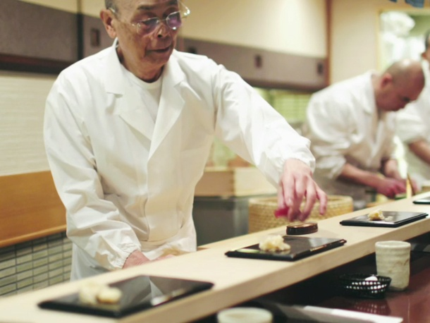 "A master sushi chef - Jiro Ono is 87 yrs working out of a tiny kitchen in the basement of a Tokyo office building.  culinary superstar. Jiro was Immortalized in a recent documentary, ""Jiro Dreams of Sushi."""