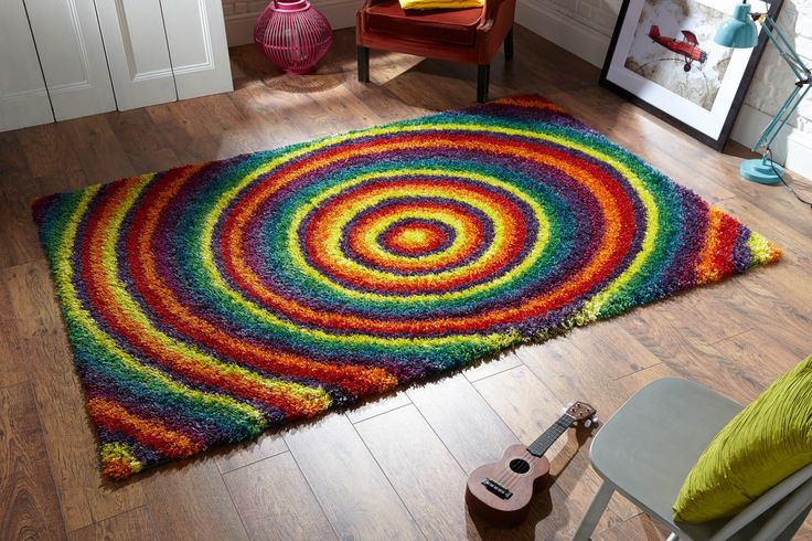 Vibrant & Colourful. Nice multicoloured circular design. Amazing shaggy texture. It's a great rug to have!  #shaggyrugs #multicolouredrugs #largerugs #modernrugs #polyesterrugs #shinyrugs