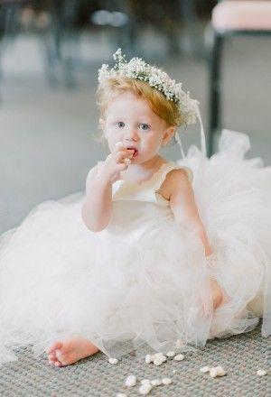This young flower girl with a baby's breath crown has got to be the cutest flower girl I've ever seen!