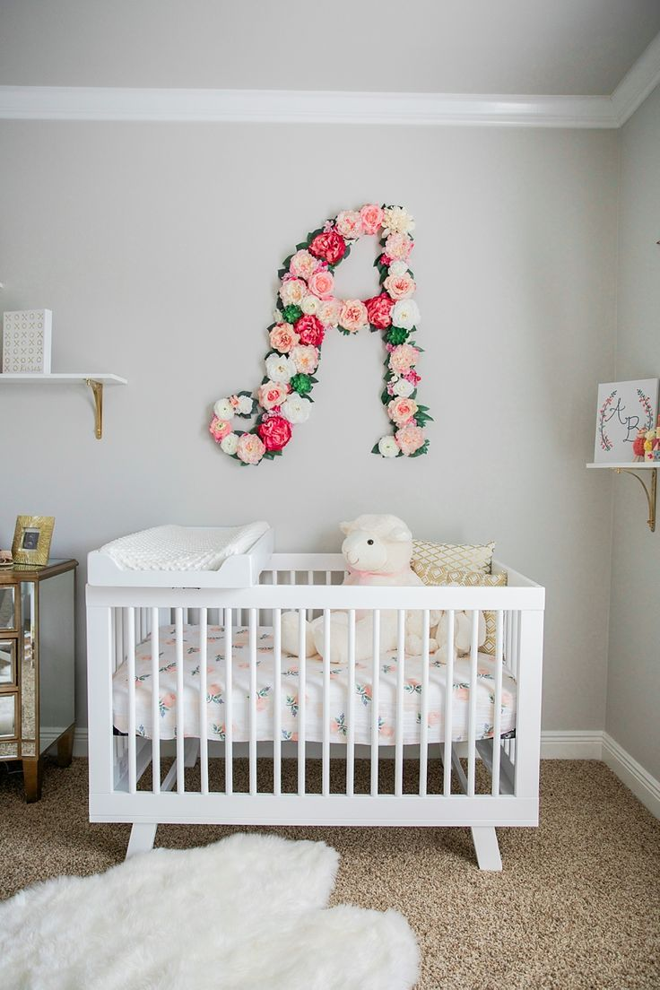 Baby girl nursery with floral wall monogram