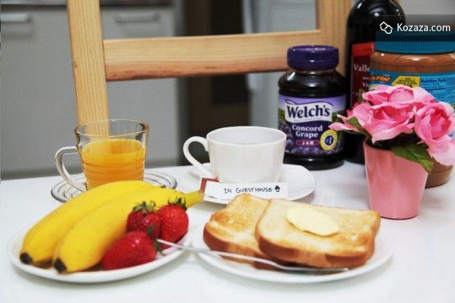 free breakfast (with toast, coffee, juice, jam, fruits, egg)
