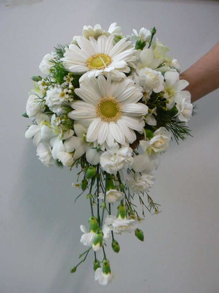 White orchids mixed with mini gerberas, spray carnations & Geraldton wax