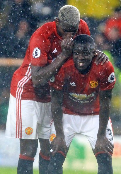 Manchester United's French midfielder Paul Pogba whispers to Manchester United's…