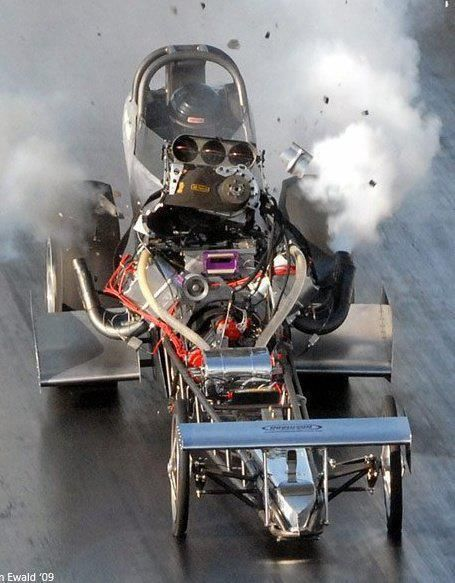 Wow! If you look closely, you will note the photographer has caught this Dragster 'Coming Apart', explosively!! And the 'butterflies' are wide open!