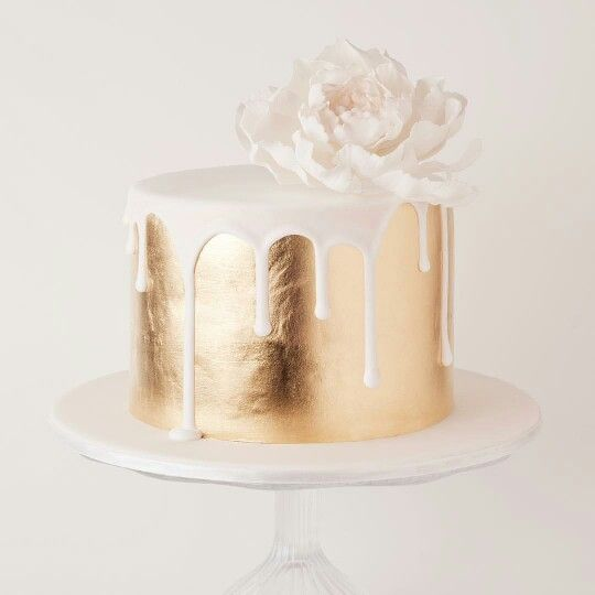 Gold Cake with White Drip and Flower