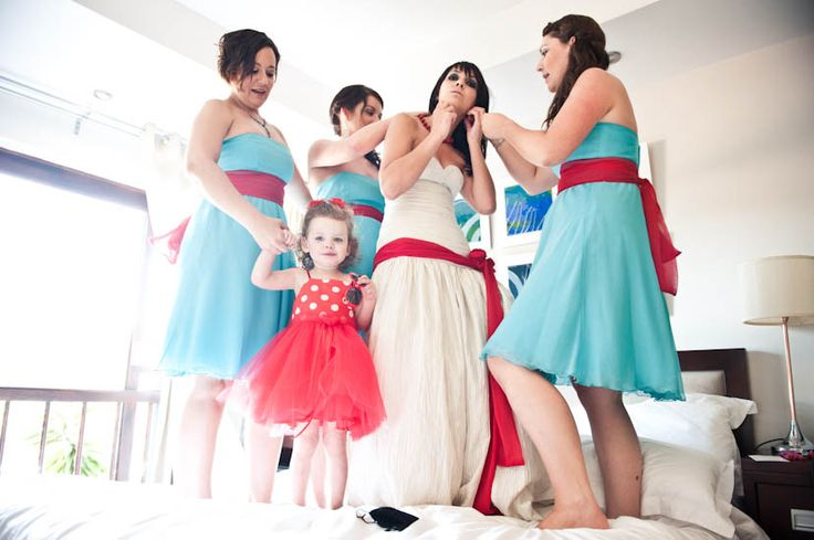 Not so much the colours in this pic but I've seen before where the bride has a sash which matches the colours of her bridesmaids' dresses and it looks really nice - dunno if that appeals to you Sarah....
