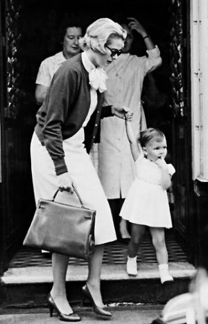 {Grace Kelly carrying her namesake bag by Hermes}  www.socialiteauctions.com