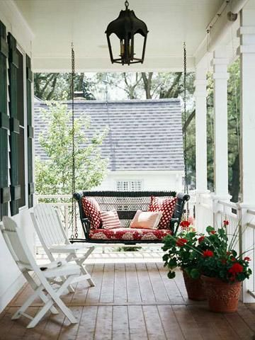 Porch swing with patterned pillows. Perfect for relaxing reading. + 26 Ideas for the Perfect Porches    http://www.midwestliving.com/homes/outdoor-living/16-porch-ideas/page/7/0#