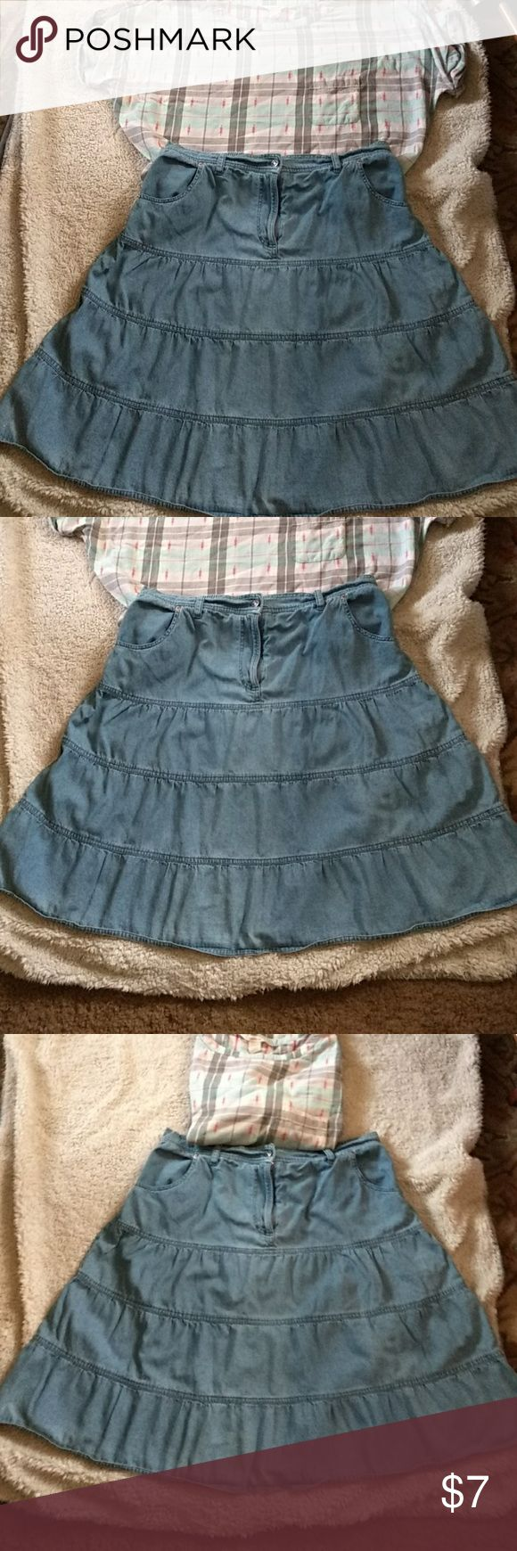 Blue jean skirt Light wash blue jean skirt. Seam layers for teir look. 100 %cotton.  Button and zip front amd 2 front pockets  Elastic band in back of waist. Xl. Paired nice with plaid shirt(sold seperate.) Southwest canyon Skirts Mini