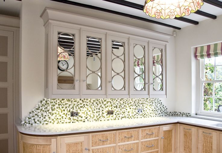 Interesting kitchen wall cabinet with a touch of glamour