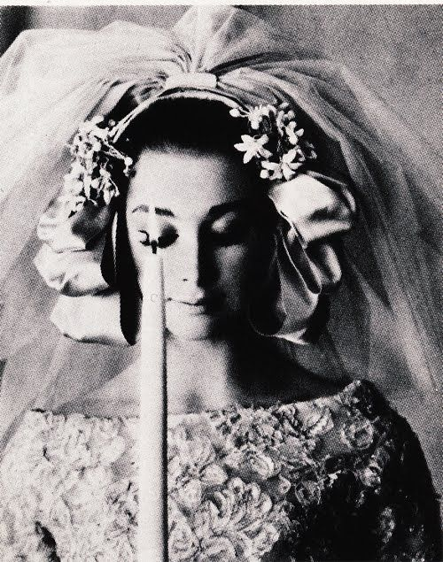 Christian Dior    Model is wearing a Bride creation by Christian Dior and photographed by  Guy Bourdin.  French Vogue,March 1961.