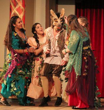 A Midsummer Night's Dream: Nick Bottom (Justin Wallis) having fun with Titania's fairies.  Courtesy Valerie O'Riordan, Archbishop Riordan High School #theatre