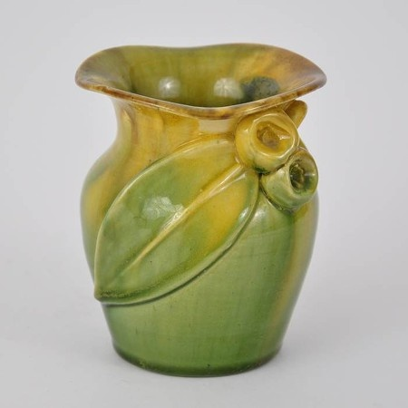 Remued pottery flared vase featuring an applied gumleaf with two gumnuts and small branch to the front. From the early Remued series, dating between 1934-1940