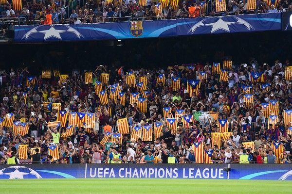 """FC Barcelona supporters wave """"Esteladas"""" pro-independence Catalan flags during the UEFA Champions League football match FC Barcelona vs Celtic FC at the Camp Nou stadium in Barcelona on September 13, 2016. / AFP / JOSEP LAGO"""