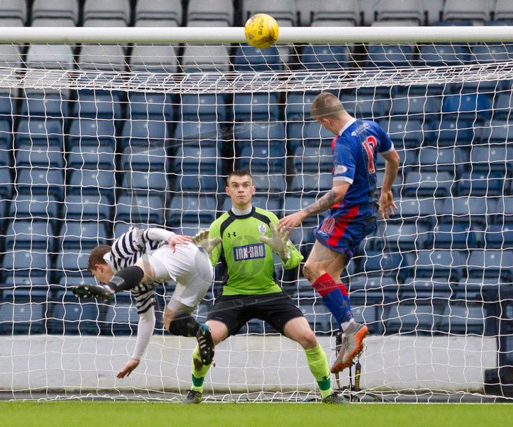 Elgin City's Kyle McLeod heads the ball during the SPFL League Two game between Queen's Park and Elgin City.