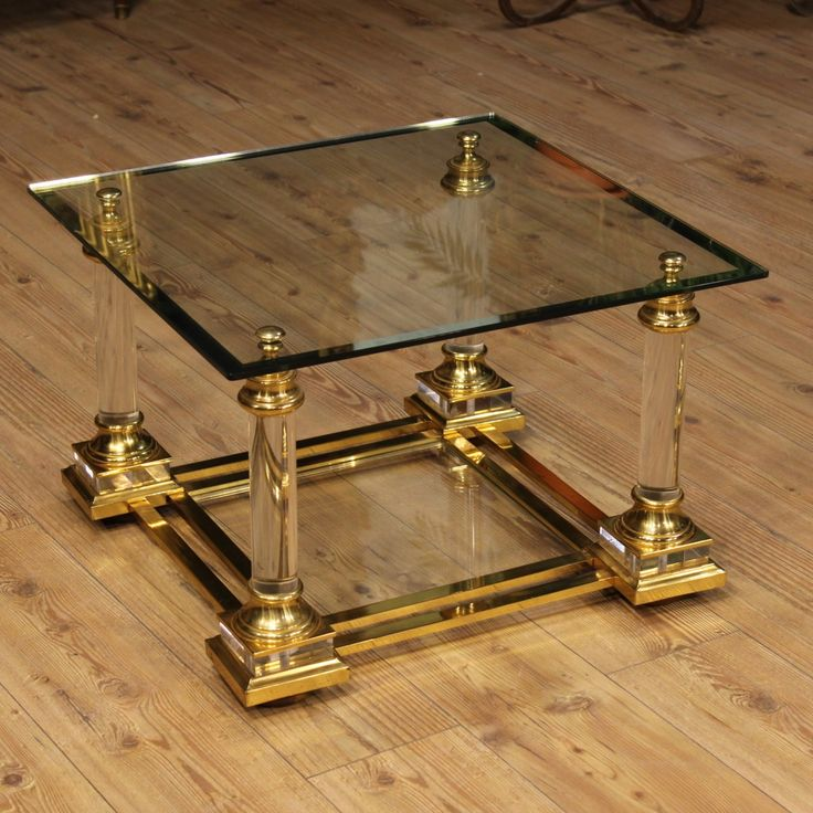 Price: 680€ Coffee table of the 20th century of Italian designer. Furniture built with glass tops, plexiglass structure, golden base and decorations in brass. Coffee table with double shelf. In good condition with some small signs of the time. #antiques #antiquariato Visit our website www.parino.it