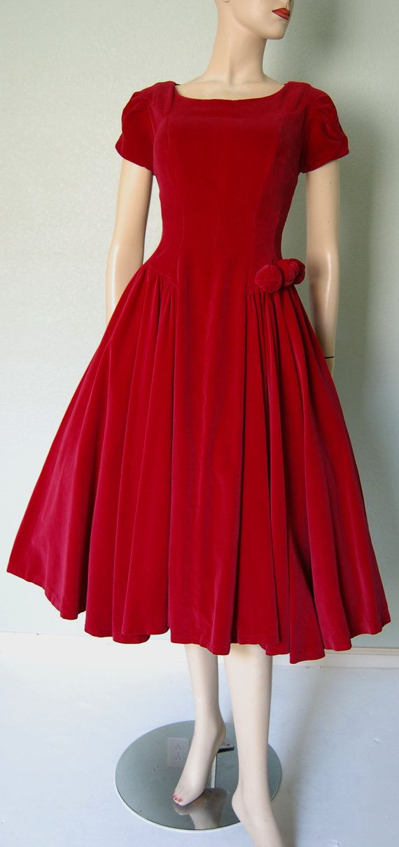 Believe it or not, my mother wore dresses like this.  In fact, after she died I found in one of her closets a burgundy velvet coat with flared skirt and empire waistline with gold satin lining and gold buttons.  VERY Jackie O./Camelot.  Just need to get back into a size 6 to wear it.  HA.  But where to wear?!