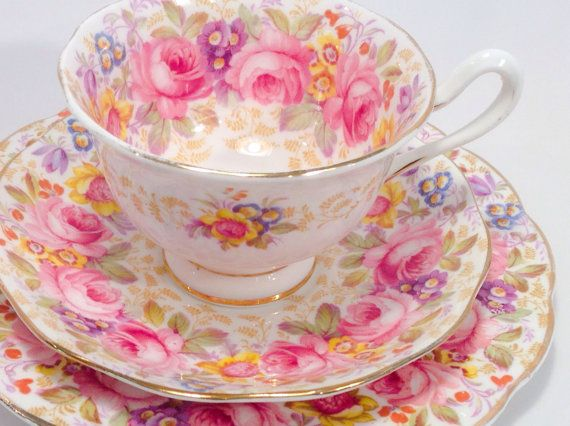 Vintage Royal Albert Fine Bone China tea cup, saucer and dessert plate. This trio has the Serena pattern and features large pink roses with an