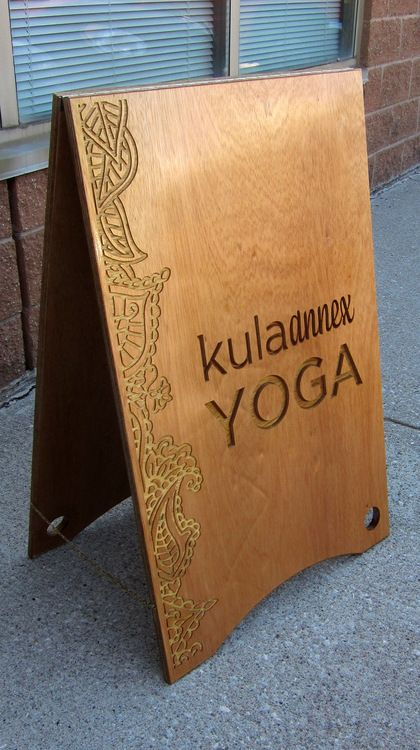 Sandwich board for local Yoga Studio.  Meranti Ply carved with CNC Stainless and brass hardware.