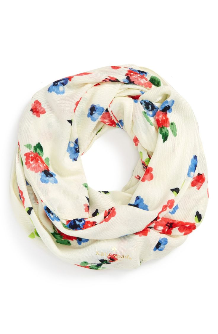 Bright floral blooms intensify this pretty Kate Spade infinity scarf.