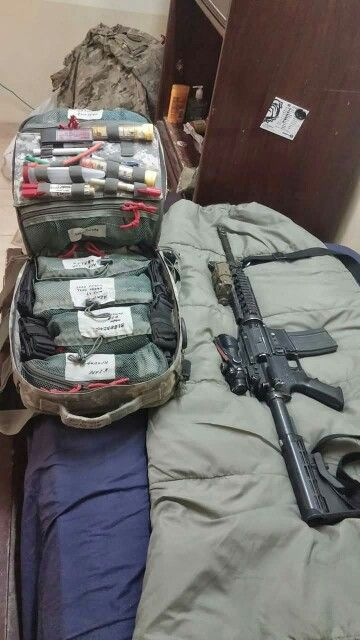 Combat medic bag next to his protection.