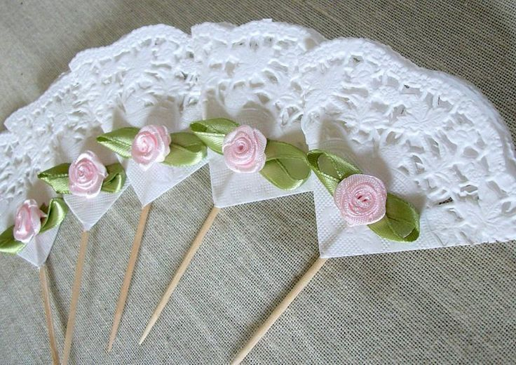 Paper lace fan cupcake toppers......one of a kind fan shaped cupcake picks to make your cupcakes extra special. Great for a birthday parties, anniversaries, bridal shower, baby girl shower, tea parties, or Mother's Day.     These are made from wooden picks, lace paper and pink ribbon roses.... I have used non-toxic glue to put them together with.    These are ready to ship and you will receive 24     Measures: about 4 inches tall by 3 inches wide