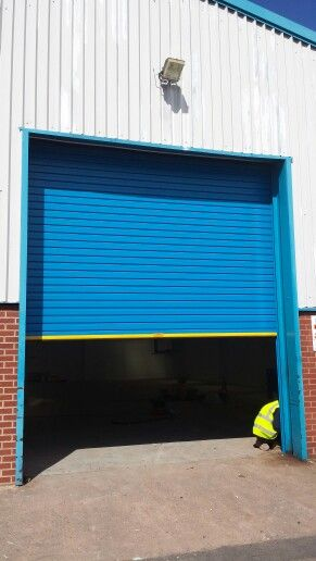 Industrial insulated power operated roller shutter door with plastisol external finish