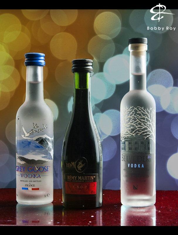 A photo-shoot of some beautiful miniature liquor bottles.