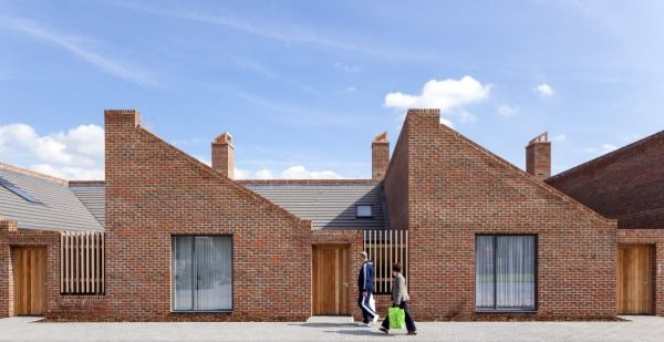 Mono pitch roofscape with brick facade