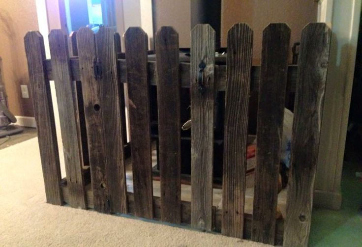 I didn't want a traditional fireplace gate (since the babies mobile this year) so my husband made this crazy cute fence from old scrap barn wood! Love it and his crafty skills! Anything I want, he makes happens! *spoiled* ;))