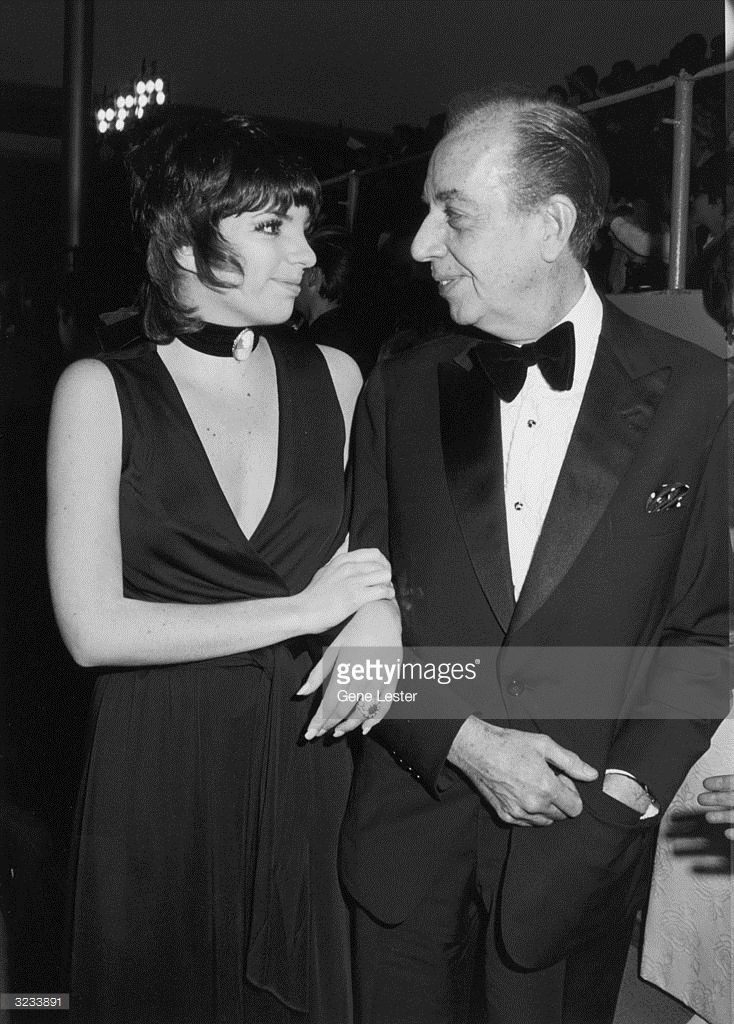 EXCLUSIVE American actor and singer Liza Minnelli and her father, American film director Vincente Minnelli smile at each other at the Academy Awards, Dorothy Chandler Pavilion, L.A. County Music Center, Los Angeles, California. Liza was nominated as Best Actress for her role in director Alan J. Pakula's film, 'The Sterile Cuckoo.' She wears a black evening dress and a choker with a cameo.