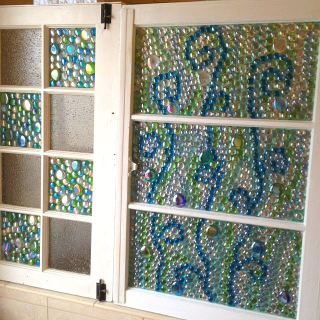 Old windows with glass beads glued on with glass glue.