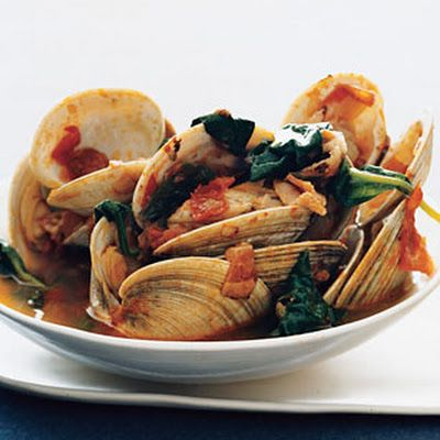Oven-roasted Clams with Bacon, Chanterelles, and Tomatoes