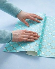 I'll never wrap a gift the same way again. [Wrap a gift with a pocket for holding the card.]