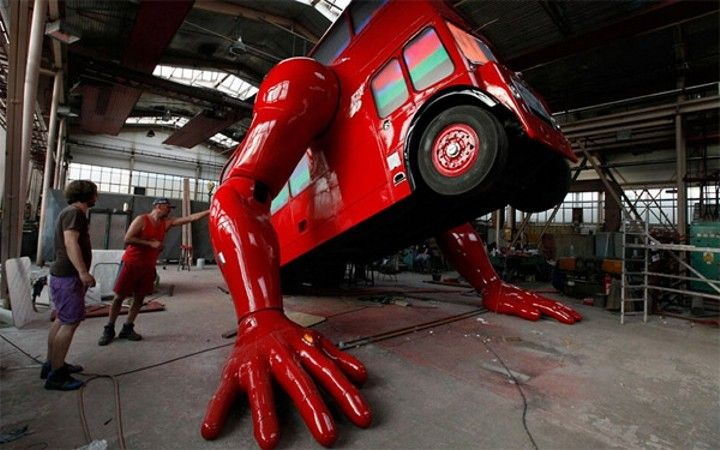 Pumped for the Olympics? So is This Big Red Bus That Does Push-ups!