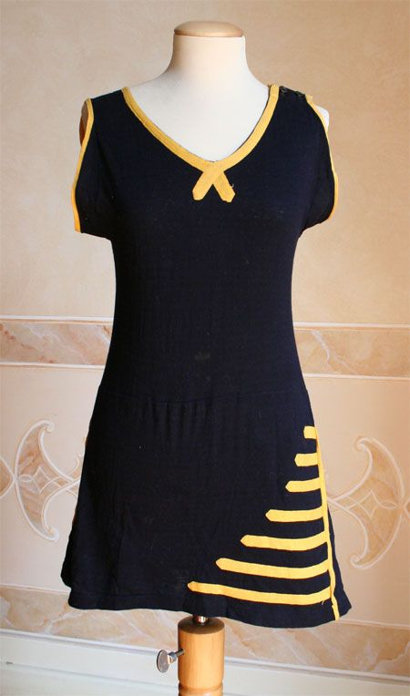 1925 Blue knitted wool Swimsuit with yellow applications. Consists of a single piece of shorts and full skirt.